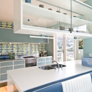 View of a kitchen which features blue cabinetry architecture, furniture, interior design, product design, white