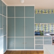 View of blue-painted kitchen cabinetry. - View of cabinetry, cupboard, door, floor, flooring, glass, interior design, room, tile, wall, wardrobe, gray