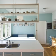 View of a kitchen which features blue cabinetry cabinetry, countertop, interior design, kitchen, room, shelf, shelving, gray