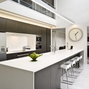 View of kitchen featuring large island, dark-stained oak countertop, interior design, kitchen, real estate, white