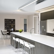 View of kitchen featuring large island, dark-stained oak architecture, countertop, daylighting, house, interior design, kitchen, product design, real estate, table, gray, white