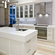 View of a renovated villa kitchen which features bathroom, bathroom accessory, countertop, floor, furniture, interior design, kitchen, product design, room, sink, tap, gray