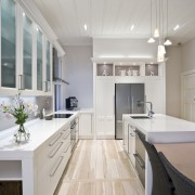 View of a renovated villa kitchen which features cabinetry, ceiling, countertop, cuisine classique, daylighting, floor, flooring, home, interior design, kitchen, room, wood flooring, gray