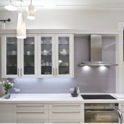 View of a renovated villa kitchen which features cabinetry, countertop, home, interior design, kitchen, room, window, gray, white