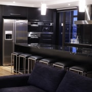 View of an apartment kitchen which features solid interior design, lighting, living room, black