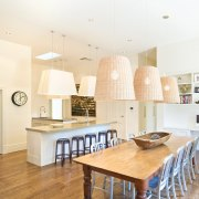 View of a kitchen and dining area featuring ceiling, countertop, cuisine classique, dining room, floor, flooring, home, interior design, kitchen, property, real estate, room, table, white