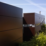 Exterior view of contemporary home with TRESPA siding, architecture, facade, home, house, roof, sky, brown, black