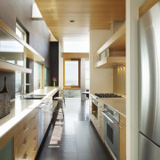 View of the narrow kitchen which features beech cabinetry, countertop, cuisine classique, interior design, kitchen, real estate, white