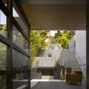View of the small courtyard and concrete stairs architecture, home, house, interior design, window, brown