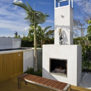 This small outdoor entertaining area and pool area fireplace, house, brown