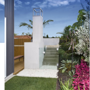 View of outdoor entertaining area which features a architecture, facade, grass, home, house, real estate