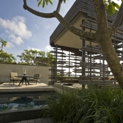 Alila Villas Uluwatu is one of the first architecture, cottage, home, house, outdoor structure, plant, tree, brown