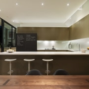 View of a renovated kitchen which features a architecture, cabinetry, ceiling, countertop, interior design, kitchen, under cabinet lighting, brown, gray