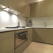 View of kitchen which features, polished concrete floors, cabinetry, countertop, floor, interior design, kitchen, property, real estate, room, sink, under cabinet lighting, brown