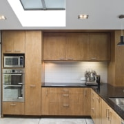 View of kitchen area with plywood cabinetry, black architecture, cabinetry, countertop, cuisine classique, house, interior design, kitchen, real estate, white, gray