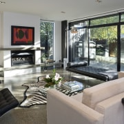 View of living room which features a day home, house, interior design, living room, property, real estate, window, gray