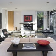 View of living room which features a day house, interior design, living room, real estate, table, gray