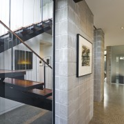 View of stairway which features glass walls, polished architecture, floor, house, interior design, lobby, real estate, gray