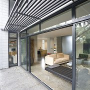 Exterior View of the rear outdoor area featuring architecture, daylighting, house, interior design, white, gray