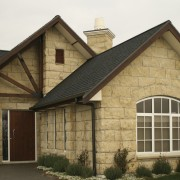 Exterior view of a home which features block building, facade, home, house, property, real estate, roof, siding, window, brown