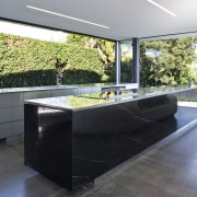 View of open-plan kitchen and living area featuring architecture, house, interior design, real estate, gray, black