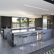 View of open-plan kitchen featuring polished concrete flooring, countertop, house, interior design, real estate, gray