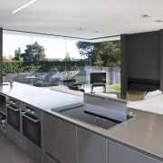 View of open-plan kitchen featuring polished concrete flooring, architecture, countertop, house, interior design, kitchen, real estate, gray, white