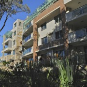 Exterior view of the Lindfield Apartments which were apartment, building, condominium, facade, home, hotel, house, mixed use, neighbourhood, property, real estate, residential area, resort, black