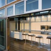 View of a kitchen designed by NKBA designer daylighting, door, glass, window