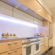 View of a kitchen designed by Mal Corbay architecture, cabinetry, ceiling, countertop, daylighting, interior design, kitchen, lighting, product design, under cabinet lighting, orange