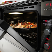 View of a kitchen which features appliances from home appliance, kitchen appliance, kitchen stove, oven, product, black