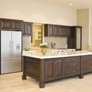 View of a kitchen which designed by a cabinetry, countertop, cuisine classique, floor, hardwood, interior design, kitchen, room, orange, brown