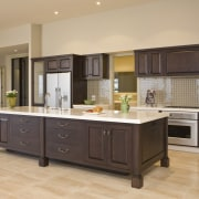 View of a kitchen which designed by a cabinetry, countertop, cuisine classique, floor, flooring, hardwood, interior design, kitchen, room, wood flooring, orange