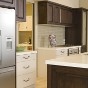 View of a kitchen which designed by a cabinetry, countertop, cuisine classique, home appliance, interior design, kitchen, room, brown, white