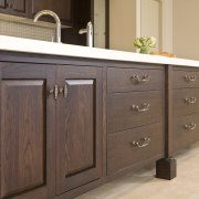 View of a kitchen which designed by a bathroom cabinet, cabinetry, chest of drawers, countertop, drawer, furniture, hardwood, kitchen, product, sideboard, wood stain, brown