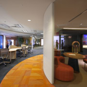 View of office workstations which feature curved desks, architecture, ceiling, interior design, lobby, office, brown, gray