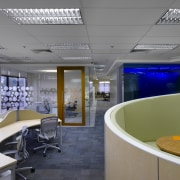 View of office workstations which feature curved desks, ceiling, interior design, office, gray