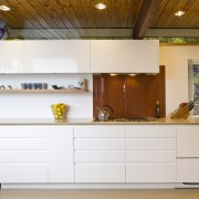 view of a kitchen which features white-lacquered cabinetry cabinetry, countertop, cuisine classique, interior design, kitchen, white, brown