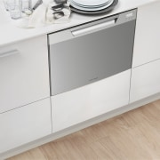 View of a kitchen which features appliances from chest of drawers, floor, furniture, product, product design, sideboard, white