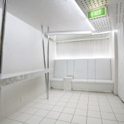 View of the all-white ante-room with floor and architecture, daylighting, floor, interior design, room, gray, white