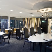 View of the main dining area of a furniture, interior design, restaurant, table, gray