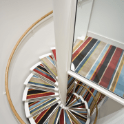 view of a spiral staircase leading up to furniture, product design, table, gray