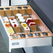 View of custom storage solutions available from Hettitch. display case, drawer, furniture, product, white