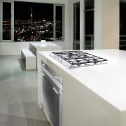 Designed by Hacker Kitchens, this kitchen features appliances countertop, floor, flooring, interior design, kitchen, product design, gray