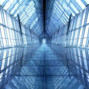 Interior view of the sky bridge which has architecture, blue, building, daylighting, daytime, energy, line, sky, skyscraper, structure, symmetry, teal, blue