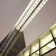 Exterior view of the glass-clad sky bridge at angle, architecture, building, ceiling, daylighting, daytime, facade, glass, light, line, skyscraper, structure, window, gray