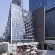Exterior view of the front entrance which features architecture, building, city, commercial building, corporate headquarters, daytime, facade, headquarters, metropolis, metropolitan area, mixed use, plaza, sky, skyscraper, tower block, gray, blue