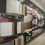 View of an Apollo Kitchens showroom which showcases interior design, retail, shelving, gray, black