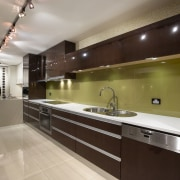 View of an Apollo Kitchens showroom which showcases cabinetry, countertop, cuisine classique, interior design, kitchen, real estate, brown, gray