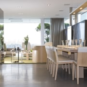 View of the dining area which is separated dining room, floor, flooring, furniture, interior design, lobby, table, gray, white